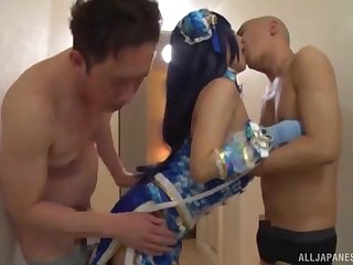 Japanese MILF in a costume blows two big hard cocks