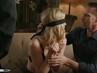 Blind folded blonde in sexy lingerie Mona Wales is fucked by two horny dudes