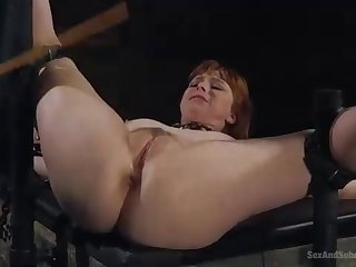 Nasty, crimson haired woman is getting strapped up and humped stiff, while bellowing from elation