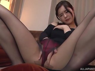 Solo Japanese MILF model Kumamiya Yoshino masturbates in pantyhose