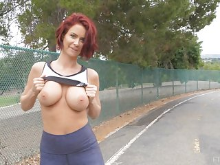 Sporty short haired redhead babe Emily flashes her tits in public