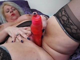 Busty mature amateur blonde granny Ann masturbates with toys