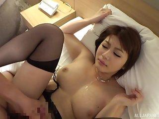 Amazing Oshikawa Yuri likes to jerk a dick with her tits