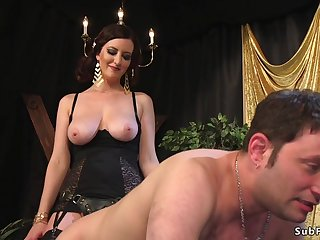Bosomy domme whips male slave in doggy-style