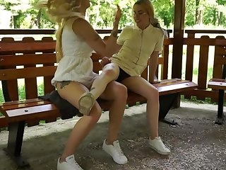 Blond teens flash in public park