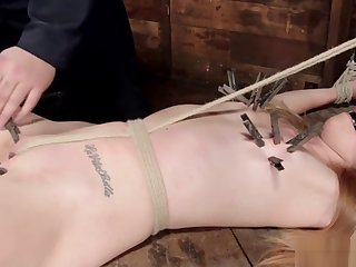 Hogtied blonde slave spanked in dungeon