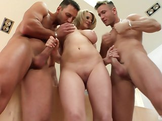 Stunning blonde Tammy likes to suck two dicks at the same time