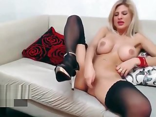A blonde cam girl maturbating on webcam