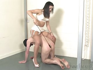 Dominant brunette whips her man and forces him to obey