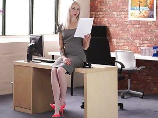 Slender secretary Ashleigh Doll is reading erotic stories in the office