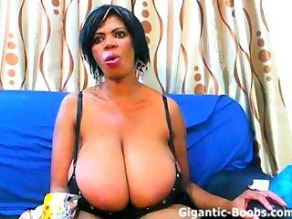 Mature ebony with gigantic tits