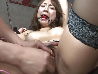 Hot sex slave gilr gets her clit teased with toys in a dungeon