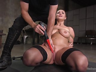 The man spanks her ass and tits then fucks her merciless