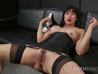 Asian whore sticks large toys in both holes during a rare solo