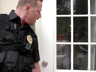 Crooked cop fucks a sexy bitch with his horny colleague