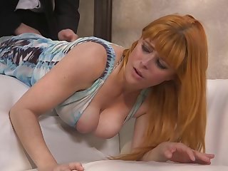 After giving steamy deepthroat blowjob busty redhead Penny Pax is fucked hard