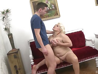 Mature aunt likes the young cock soaking her tits like that