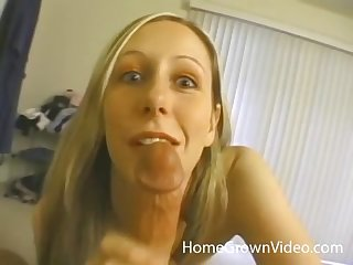 Blue eyed blonde MILF gives a hardcore blowjob to her husband
