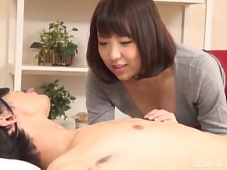 Japanese MILF rides her tied up and blindfolded husband on the bed